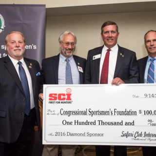 CSF President, Jeff Crane, and the Chairman of the Board of Directors, Mark DeYoung, with Representative's from SCI.