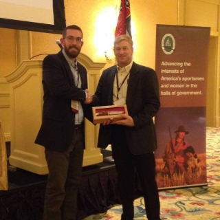 CSF Northeastern States Director, Brent Miller, awarding Joel Pedersen (NWTF) the Friends of NASC Award