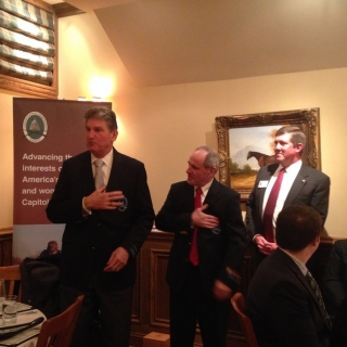 CSC Co-Chairs Sen. Joe Manchin and Sen. Jim Risch try on CSF blazers